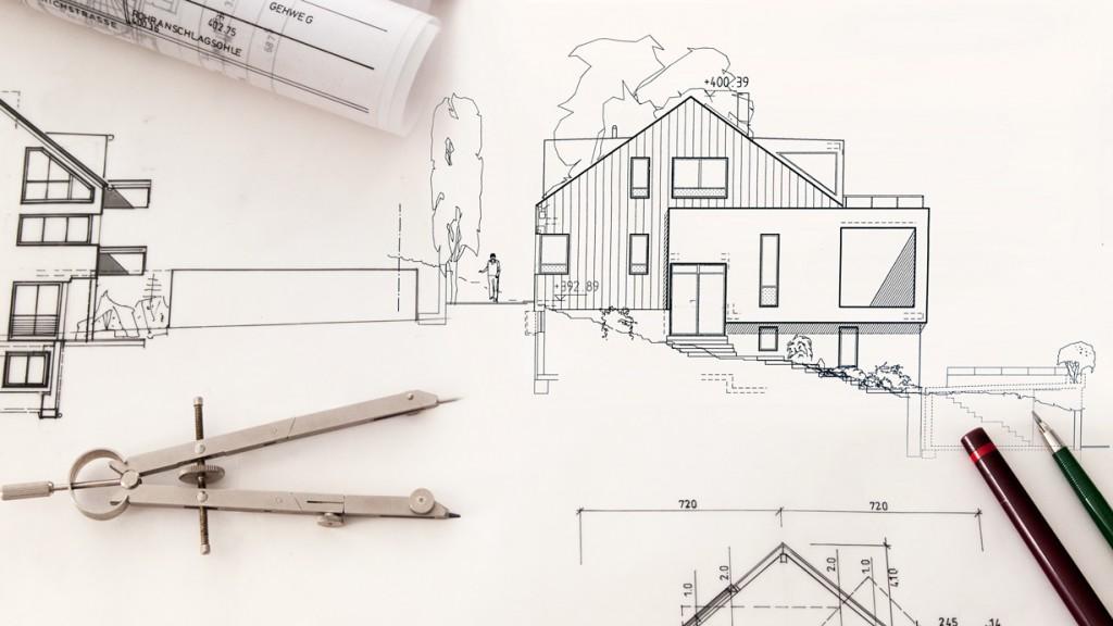 Verschiedene Baupläne und Arbeitsmittel eines Architekten